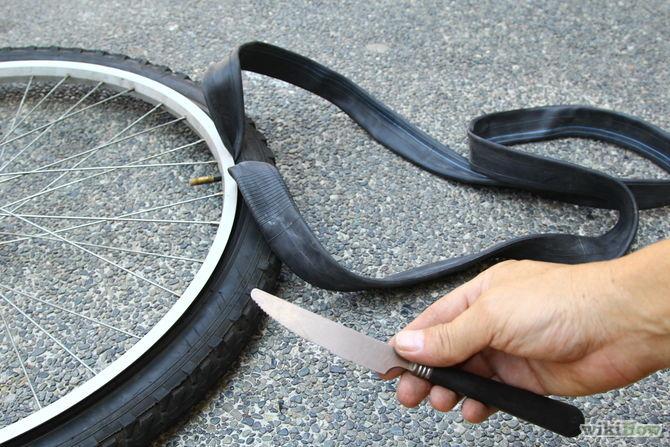 changement-pneu-vélo-couteau